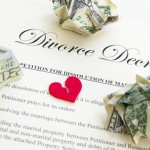 broken heart on divorce document with cash
